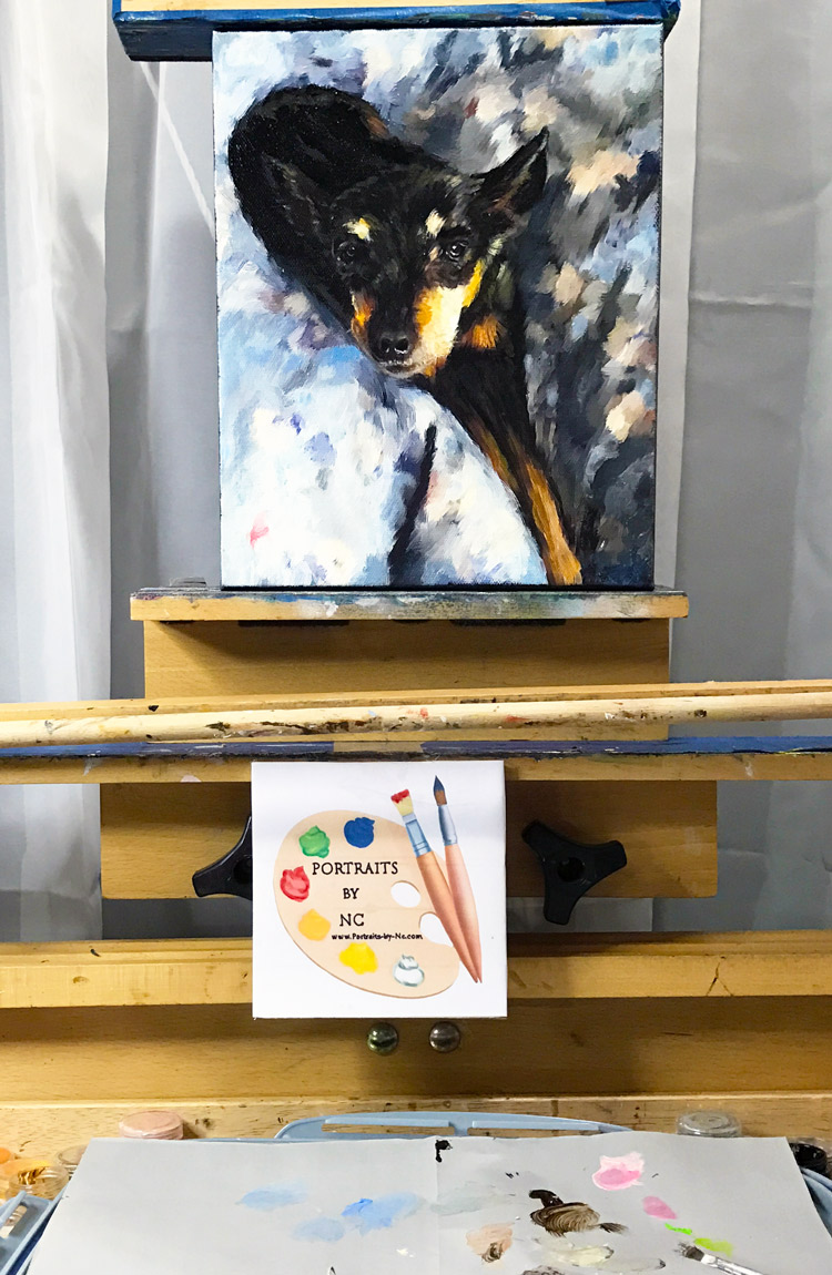 pinscher on easel