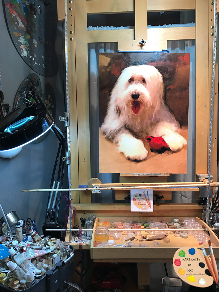 sheepdog painting on easel
