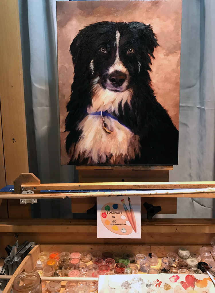 border collie on easel