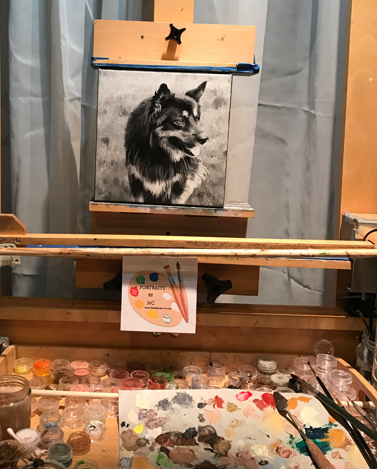 german shepherd on easel