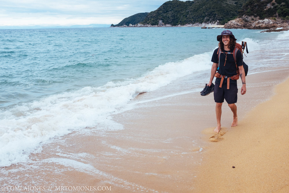 Mr Chris Wille walking the Abel Tasman sands.