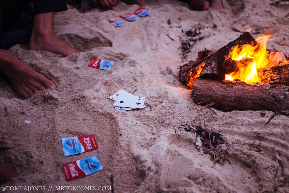 "Cards by the campfire. No-one wants the be the ""Shit-head""."