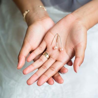 bride holding her jewelry