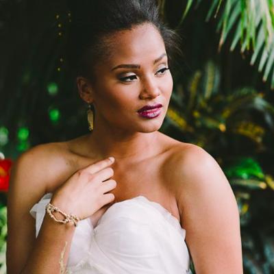bride in dress in bracelet and earrings