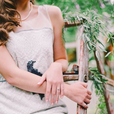 bride in her dress and platinum rings