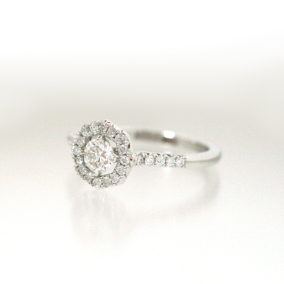 platinum and diamond french set octagon halo engagement ring