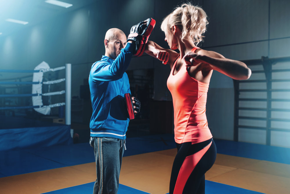 woman-on-self-defense-training-with-male-trainer-PUPN73L.jpg
