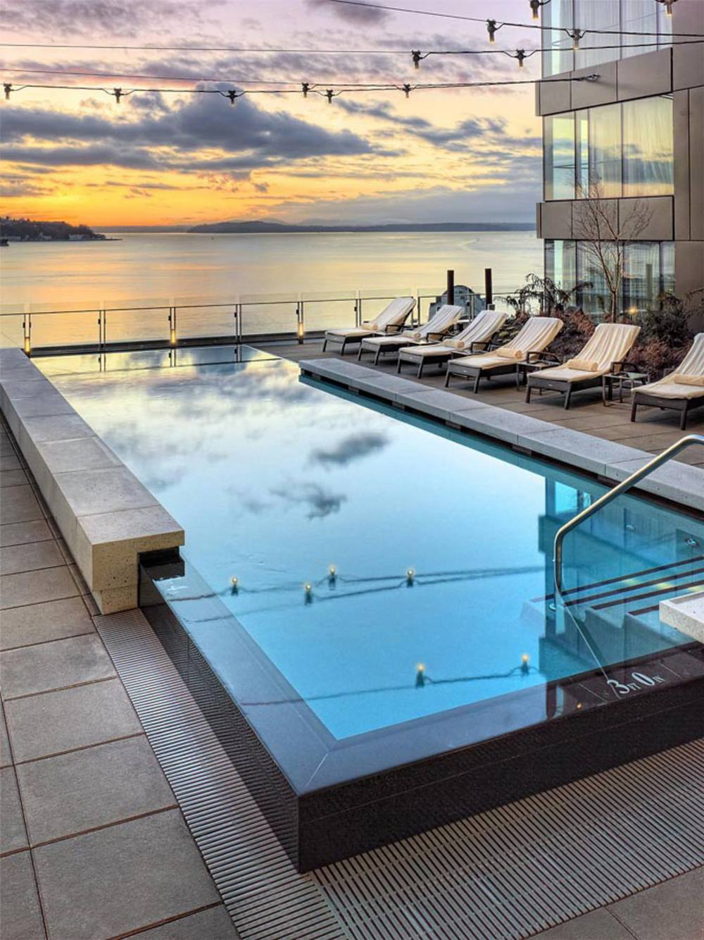 Infinity pool and rooftop views of Elliott Bay from the Four Seasons Seattle.  Photo by Four Seasons Seattle.
