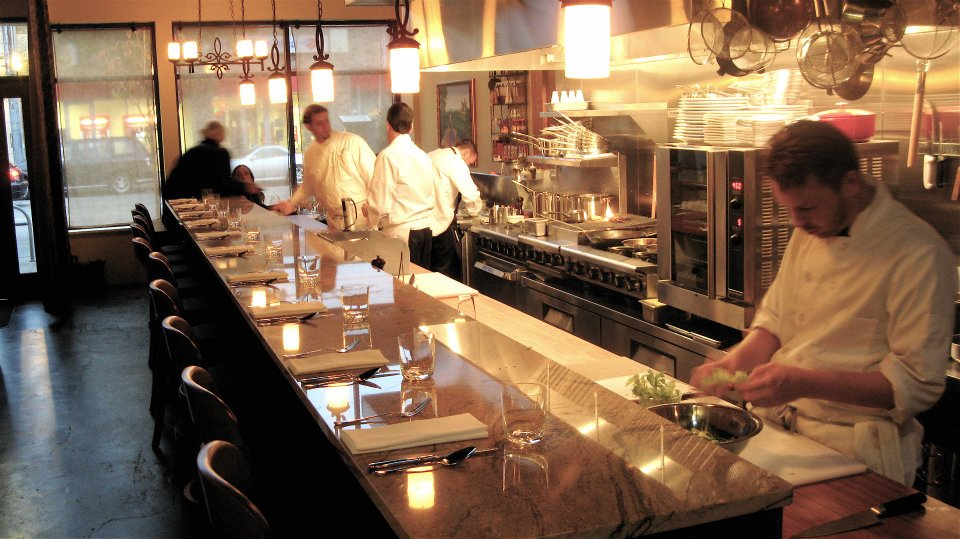 Get a seat at the bar to watch Altura's chefs in action.  Photo by Altura Restaurant.