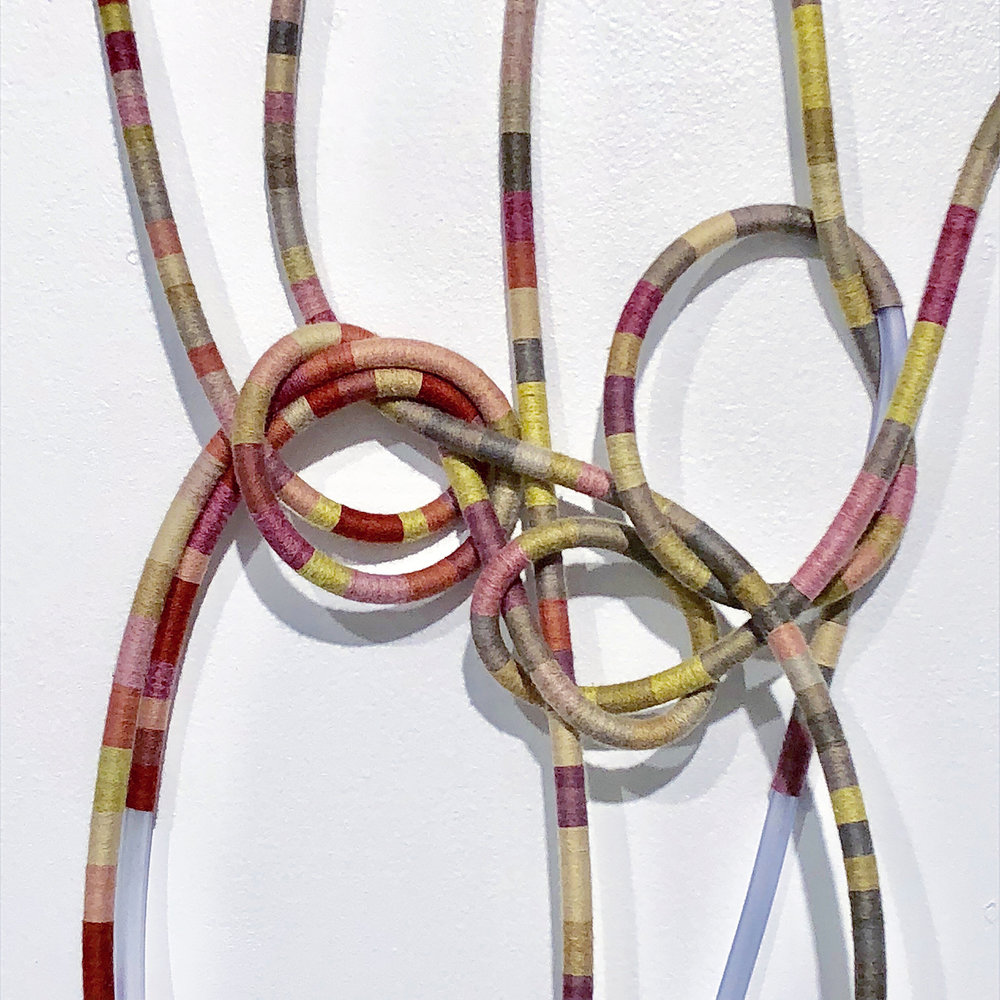 "detail of  Bound (i.3) , 2018  Climate data from the National Oceanic and Atmospheric Administration: annual average temperature for three recent homes (New York, NY, San Francisco, CA, and Tulsa, OK); petroleum-derived medical tubing wrapped with organic thread dyed with plant and insect derived dyes and mineral mordants.  Installation size variable. Each length of tubbing is 5' long and 5/16"" in diameter"
