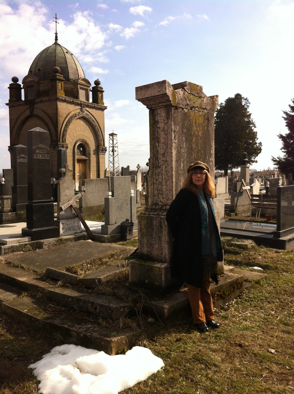 Anna at the grave of her Great-Grandfather Petar Bogdanović