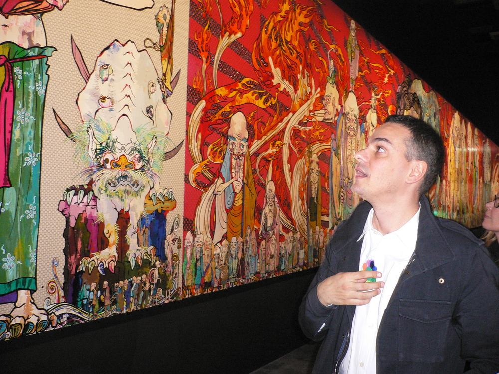 Massimiliano Gioni standing by the Arhat painting. © Lucy Rees