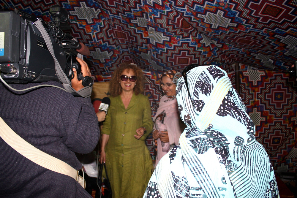 dOCUMENTA 13 director Carolyn Christov-Bakargiev giving a talk in the Sahwari Tent Cooperative, 2012.  The Art of Sahrawi Cooking  (2012) is a solitary ceremonial desert tent stitched by women from Western Sahara, prisoners in their own territory.  © Lucy Rees