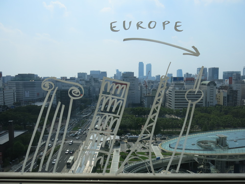 Romanian artist Dan Perjovschi's   The Top Drawing,   2013  on the window of the 11thfloor-viewing balcony of the Aichi Arts Center.