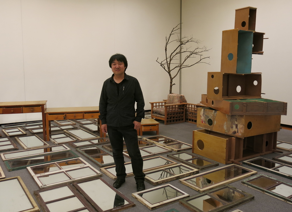 """Song Dong  with his installation """" Wisdom of the Poor""""  2010-2013, a work the artist has been developing for years which  looks at the importance of borrowing.He believes people work in the same way as politics, moving their borders and territories to claim more power. Aichi Prefectural Museum of Art."""