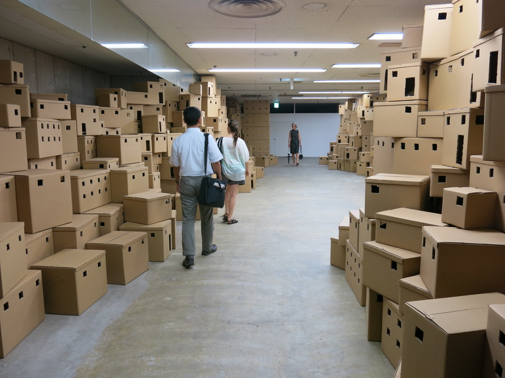 Palestinian-born UK-based artist  Bashir Makhoul 's   installation   Ghost, Exit Ghost  , 2012 - a 100m long cardboard maze that eventually leads to an Arab town or refugee camp. Images of East Jerusalem and a Palestinian refugee camp change as the viewer walks past. Okazaki CIBICO.