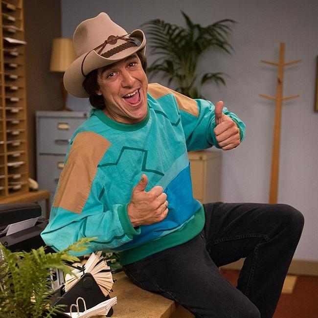 Actor Samuel Johnson portraying Molly Meldrum in 'Molly' ...back when jumpers came with shoulder pads!