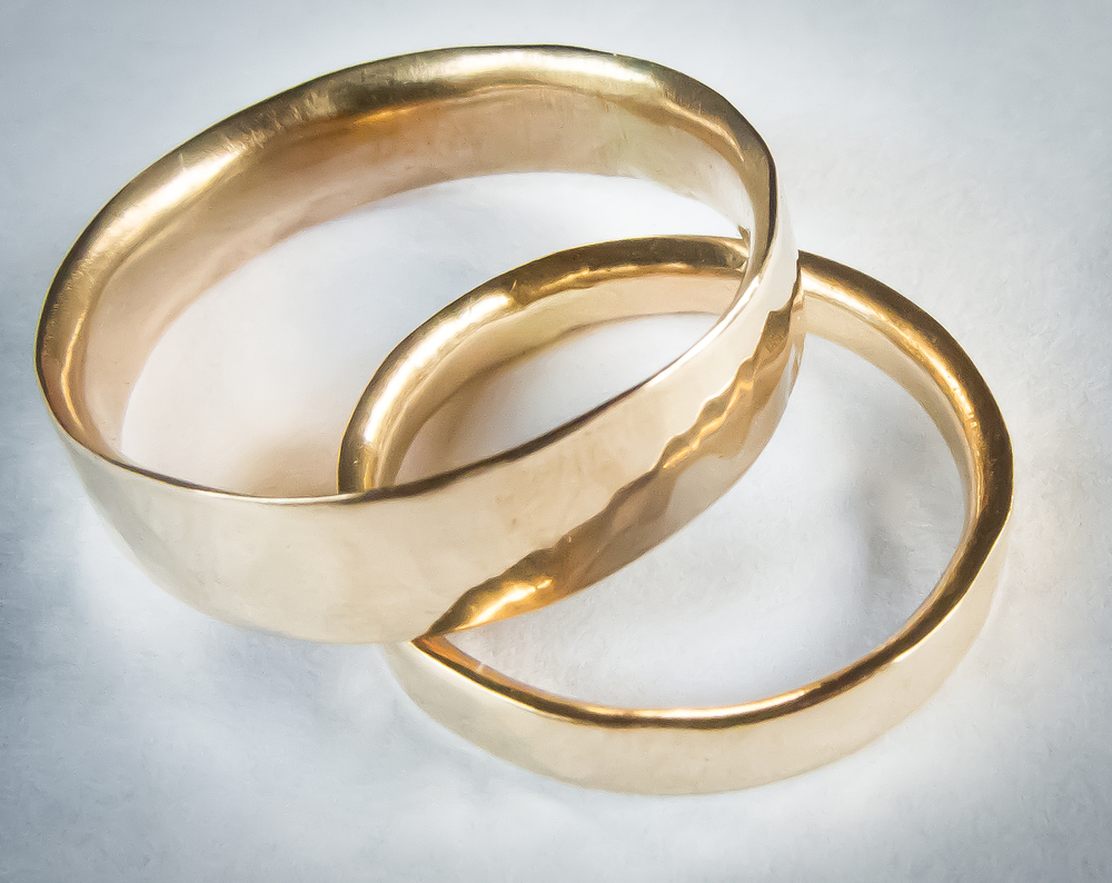 Leon and Violet's hammered rings, closeup