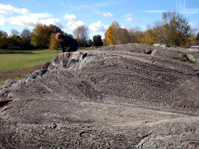 Precambrian gneiss shaped by glacial erosion. W. Erskine Johnston Elementary School, Kanata, On.   Photo by J. Aylsworth