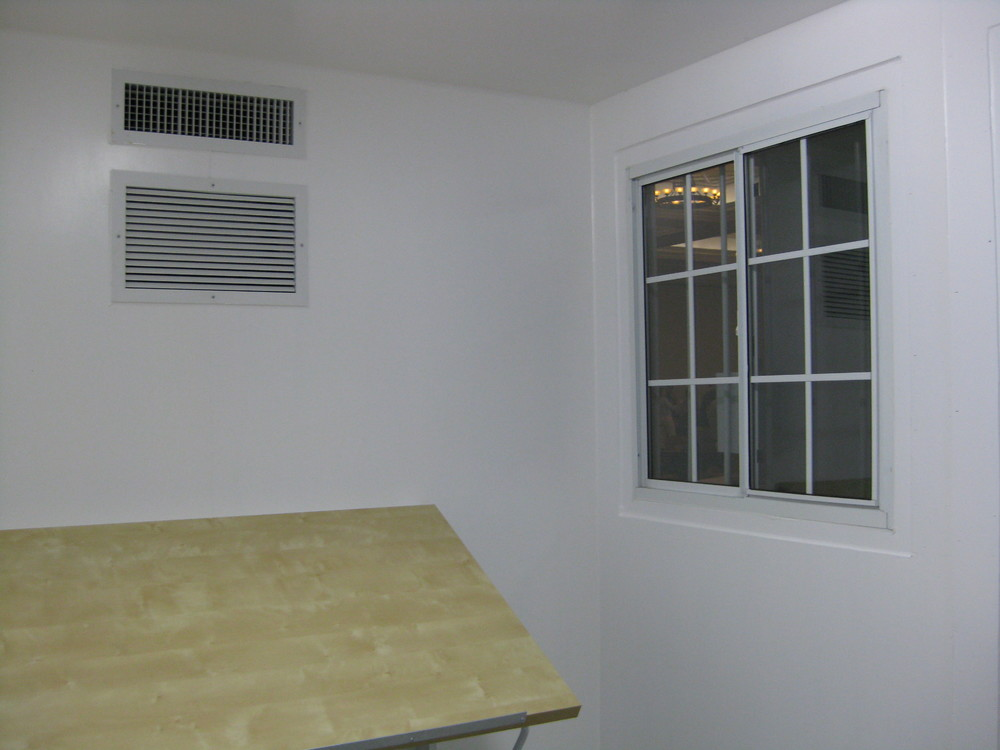 Inside finished container with window, HVAC and work table