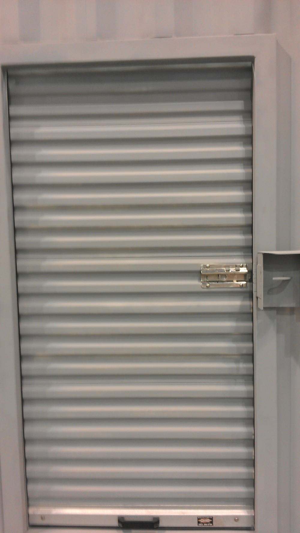 Narrow roll-up door installed with optional lockbox