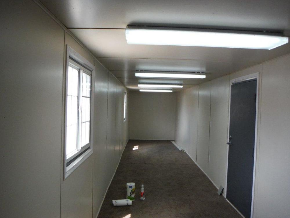 40' High Cube container converted to an office with lighting door windows insulation and flooring