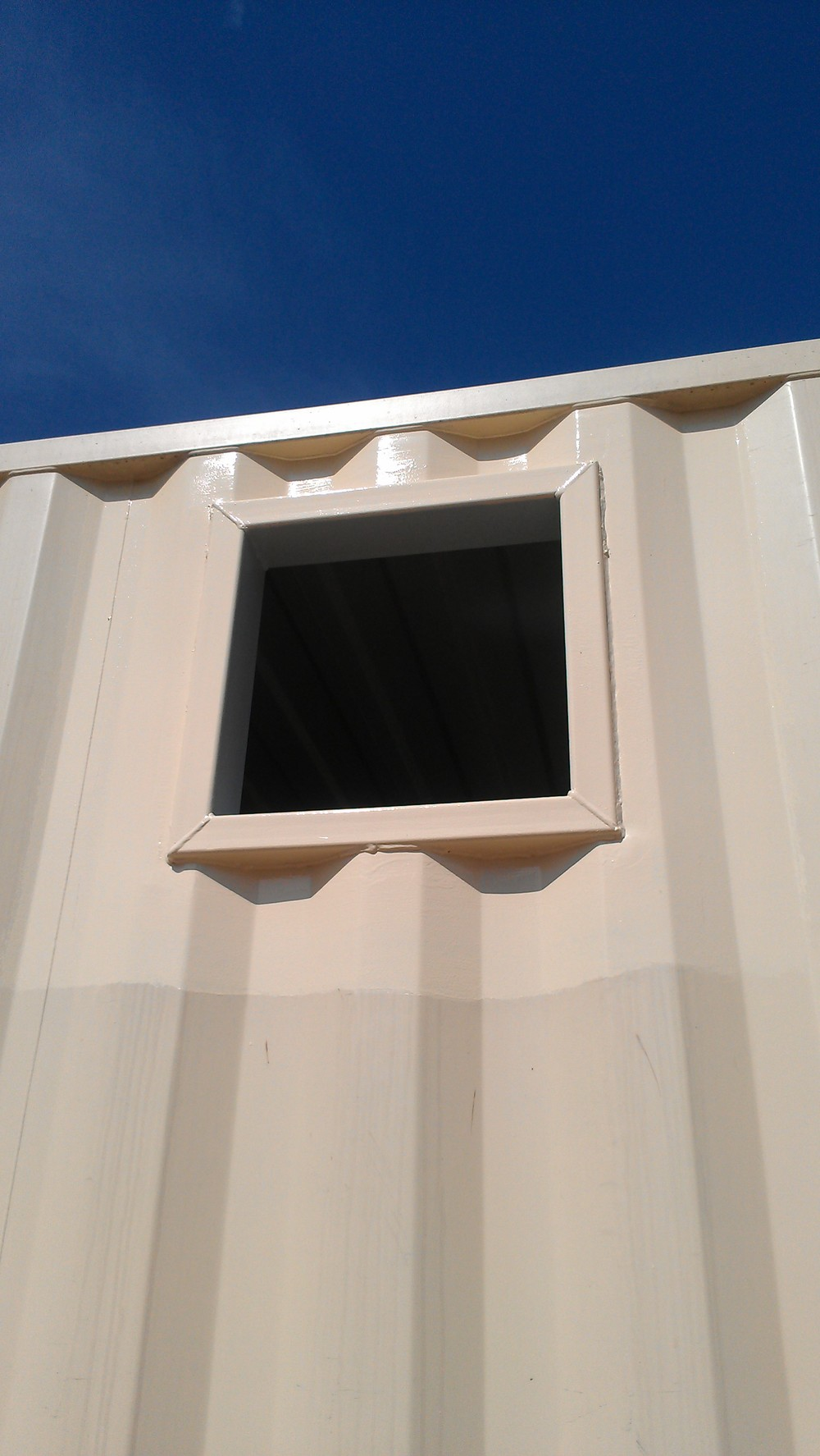 Cut and framed hole in container from outside