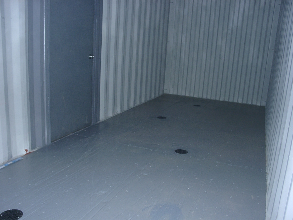 Epoxy floor with drains and service door