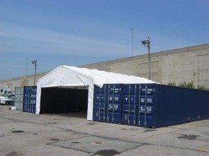 Containers with a roof between them