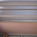 Furring strips, foam board and paneling on the ceiling