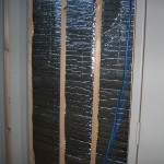 Radiant heat barrier between furring strips