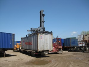 Cranes can load the container on a flat-bed or chassis