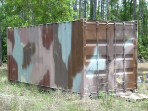Camoflage a container on your property with paint.  (Or pick a solid color that blends in)