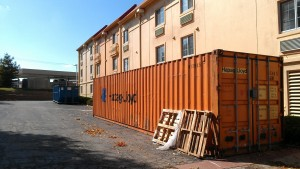 Container-by-a-hotel-300x169.jpg