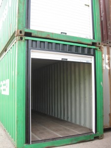 Open-roll-up door on container with painted framing