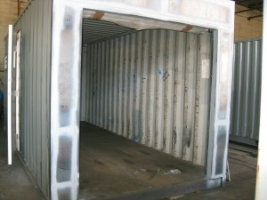 Used container prepped for roll-up door