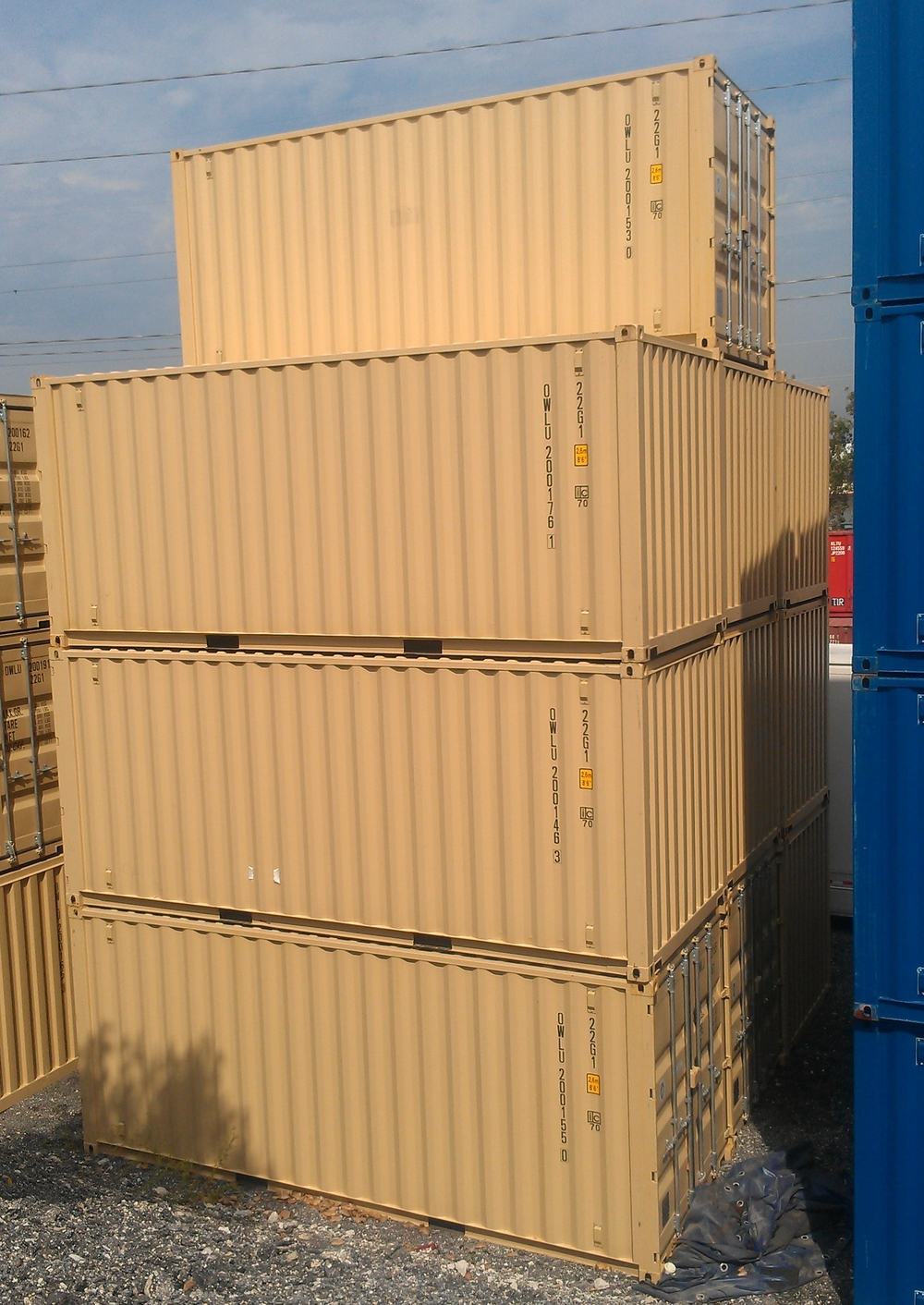 One-trip 20's stacked up.  Notice the space between the containers since they are stacked corner post to corner post.