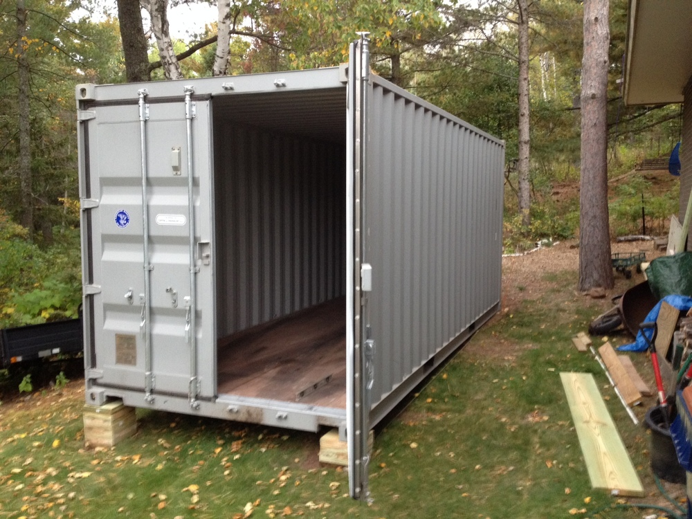 spring is a great time for a shipping container garage. Black Bedroom Furniture Sets. Home Design Ideas