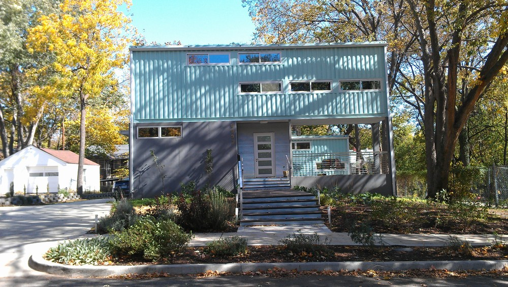 This container home is a mix of showing off the container and covering part of it up. There's not right or wrong way to go.