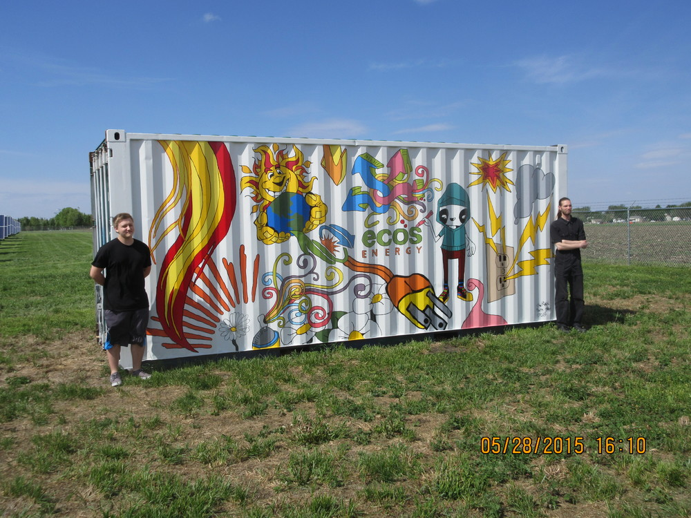 Chad Reker and Austin Miller in front of their container design