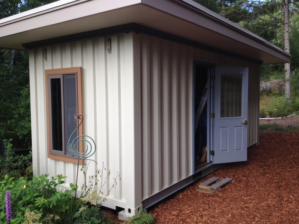 Container shed blends into the property.jpg