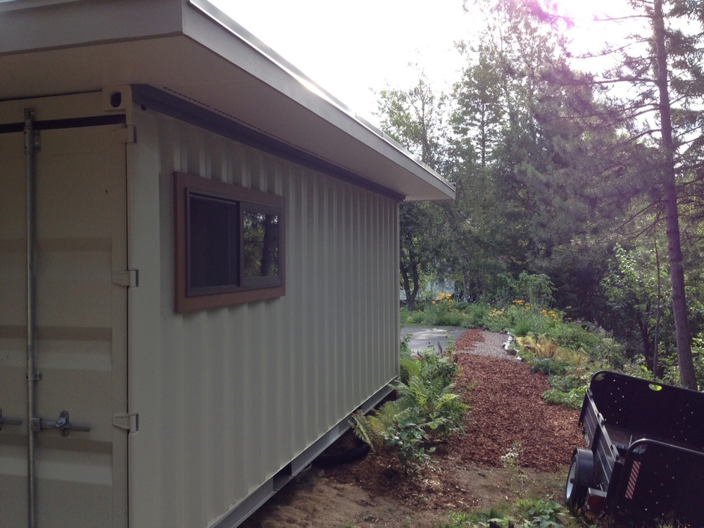 Container shed positioned just perfectly on the property.jpg