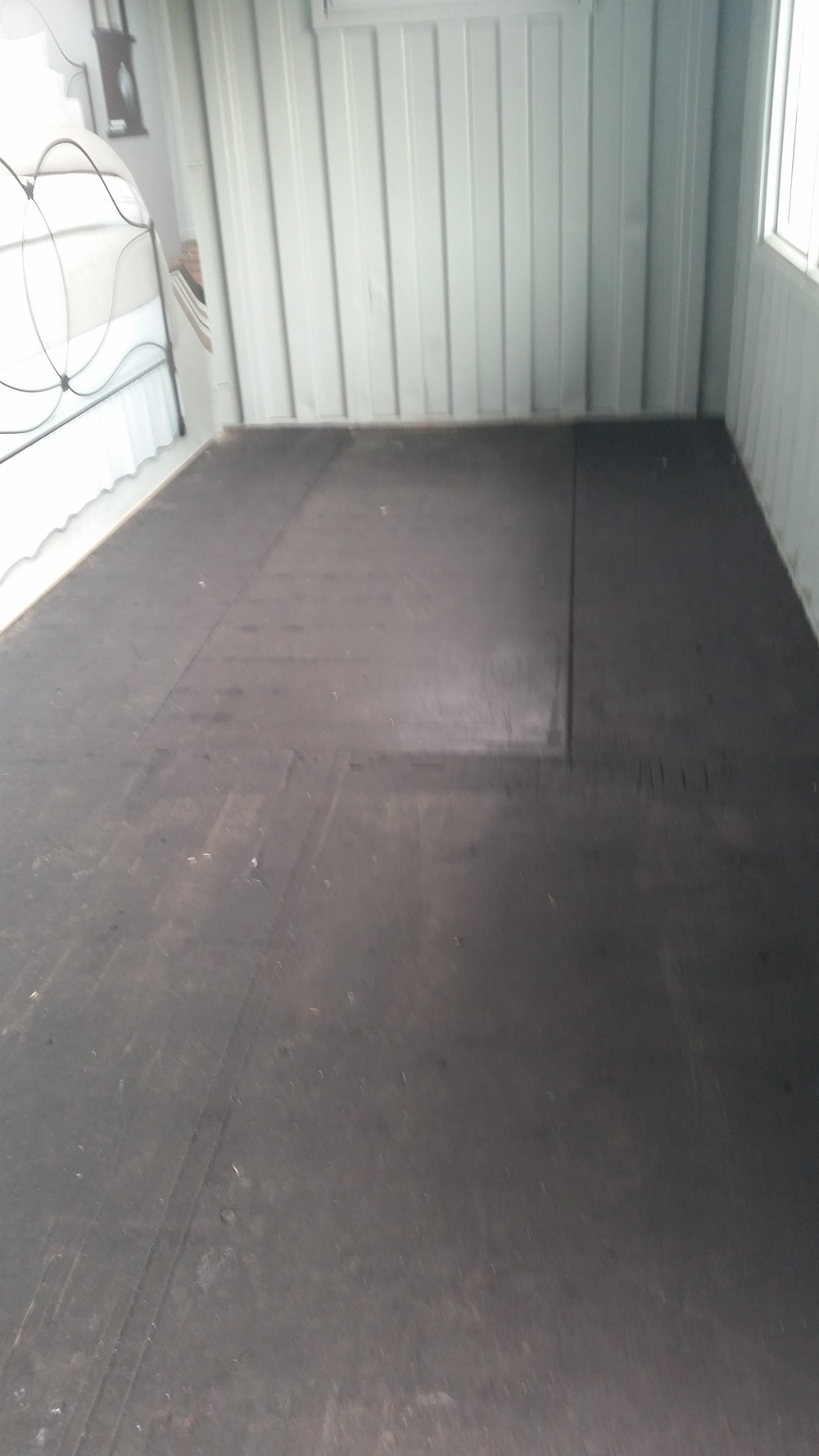 Clear epoxy floor in used container