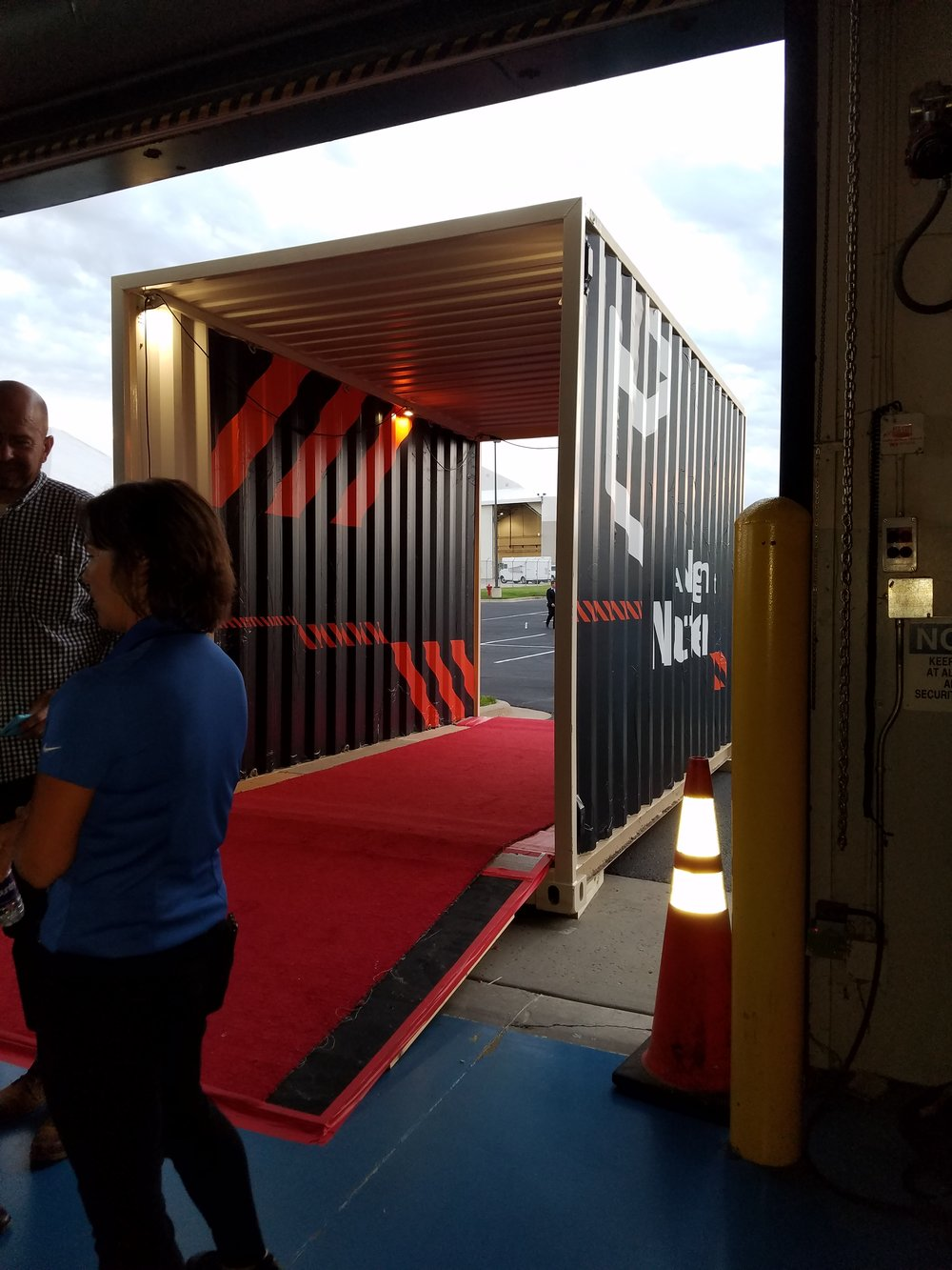 The red carpet brought people through a container