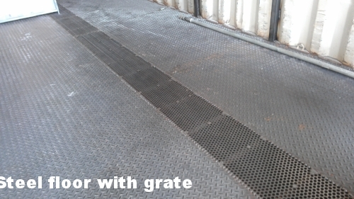 Steel floor with grate for easy clean up - and for the partition to hook into.jpg