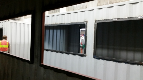Large window cut-outs on a one-trip container