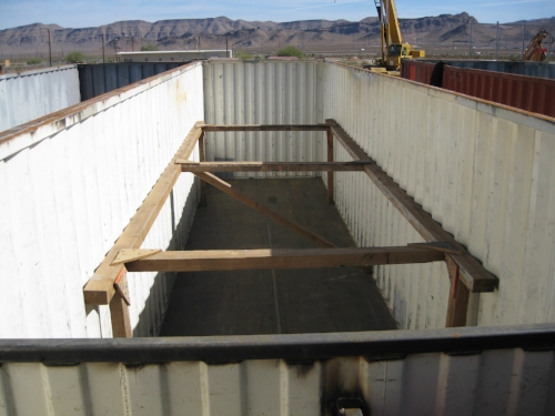 Container with top cut off and other modifications to be turned into a shrimp farm