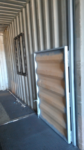 Fire training container with movable partition and window