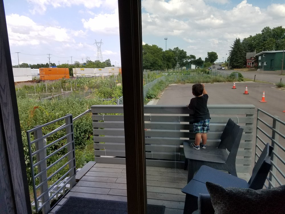 Watching trains from the patio of the hotel room.