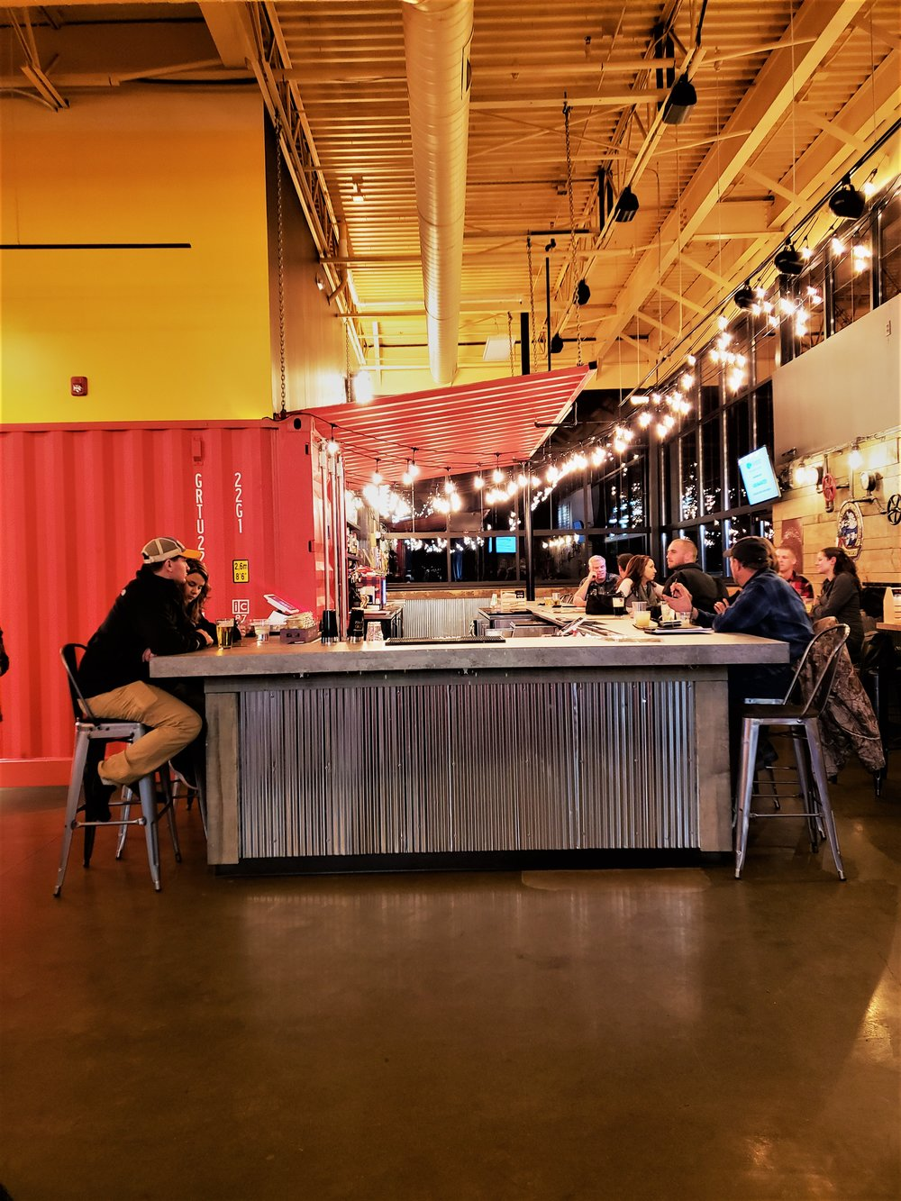 The bar at Victoria Burrow showcases shipping container decor